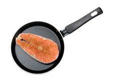 Salmon steak in a frying pan.  Stock Image