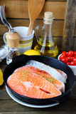 Salmon steak in a frying pan and other ingredients Stock Photo