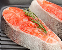 Salmon steak. On frying pans background Royalty Free Stock Photos