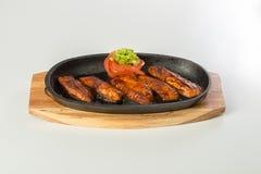 Salmon steak in the frypan Royalty Free Stock Photo