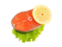 Salmon steak with greens and lemon Stock Photo