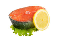 Salmon steak with greens and lemon Stock Images