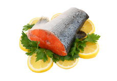 Salmon steak with greens and lemon Royalty Free Stock Image