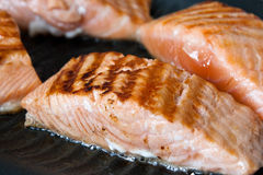 Salmon steak on grill pan Royalty Free Stock Image