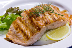 Salmon steak grilled with lemon Royalty Free Stock Images