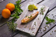 Salmon steak grilled with lime. Stock Photo