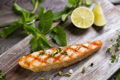 Salmon steak grilled with lime. Royalty Free Stock Images