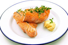 Salmon steak with herb butter. And thyme on a plate Stock Image