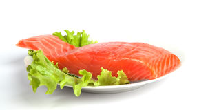 Salmon steak on leaves of salad Royalty Free Stock Images