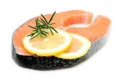 Salmon steak with lemon Royalty Free Stock Image