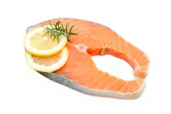 Salmon steak with lemon Royalty Free Stock Photos