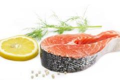 Salmon steak with lemon and dill Stock Photos
