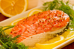 Salmon steak  with lemon, dill and coriandr Royalty Free Stock Photo