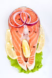 Salmon steak with lemon and onion Royalty Free Stock Photo