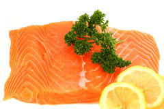 Salmon steak with lemon and parsley Stock Images