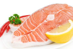 Salmon steak with lemon, pepper and parsley Stock Photos