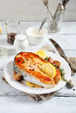 Salmon steak with lemon on a plate Stock Images