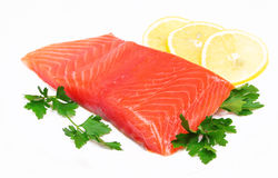 Salmon steak with lemon slice and parsley Royalty Free Stock Photography