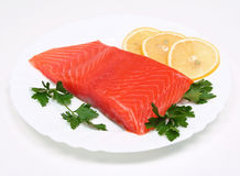 Salmon steak with lemon slices and parsley Stock Images