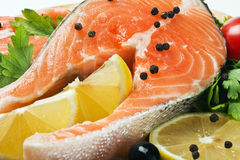 Salmon steak with lemon and spices Stock Photos