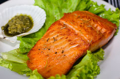 Salmon steak with lettuce and pesto sauce Royalty Free Stock Photo