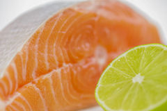 Salmon steak with lime Stock Images