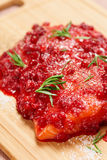 Salmon steak marinated in salt with rosemary and redberries Stock Image
