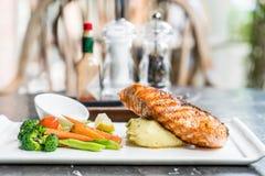 Salmon steak with mash potato and vegetable. On plate Stock Photo