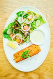 Salmon steak. Salmon meat fillet steak with vegetable salad in white plate Royalty Free Stock Image