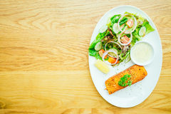 Salmon steak. Salmon meat fillet steak with vegetable salad in white plate Royalty Free Stock Photography