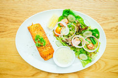 Salmon steak. Salmon meat fillet steak with vegetable salad in white plate Stock Images