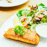 Salmon steak. Salmon meat fillet steak with vegetable salad in white plate Stock Photos