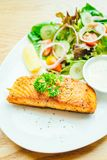 Salmon steak. Salmon meat fillet steak with vegetable salad in white plate Royalty Free Stock Photos
