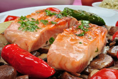 Salmon steak with mushroom and tomato. Some salmon steak with mushroom and tomato Royalty Free Stock Photography