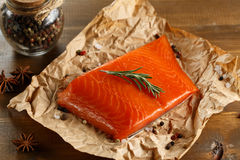 Salmon steak on old papper. Stock Images