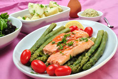 Salmon steak with organic green asparagus Stock Images