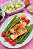 Salmon steak with organic green asparagus Royalty Free Stock Photo