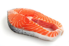 Salmon steak over white Stock Images