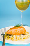 Salmon steak on pasta, decorated with dill Stock Images
