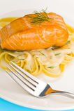 Salmon steak on pasta, decorated with dill Stock Photography