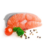 Salmon steak with pepper and parsley Stock Photography