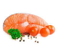 Salmon steak with pepper and parsley Royalty Free Stock Photos