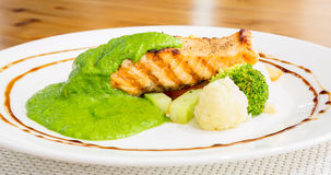 Salmon steak with pesto sauce Stock Photo