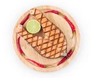 Salmon steak on platter Stock Photo