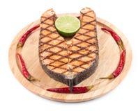 Salmon steak on platter. Royalty Free Stock Images
