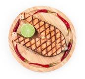 Salmon steak on platter. Stock Photo
