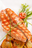 Salmon steak with potatoes Stock Image