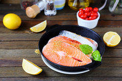 Salmon steak prepared for cooking Stock Photos