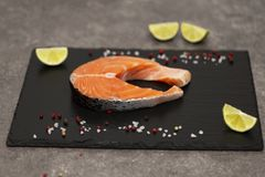 Salmon steak raw fish prepared for cooking with lime and spices. Top view royalty free stock photos