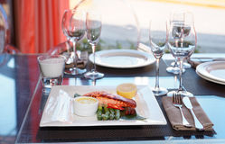 Salmon steak on restaurant table Royalty Free Stock Photos